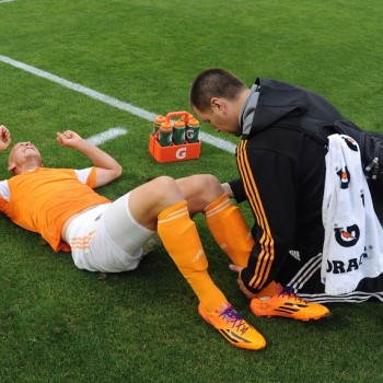 May 21, 2014; Washington, DC, USA; Houston Dynamo forward Mark Sherrod (15) is tended to by a trainer after suffering an apparent leg injury against DC United during the first half at Robert F. Kennedy Memorial. Mandatory Credit: Brad Mills-USA TODAY Sports